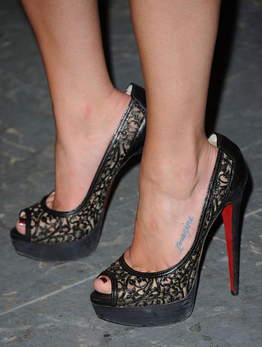 Lea Michel in black Christian Louboutin peep-toes