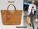 Airport Style: Charlize Theron's Gucci Madison Ostrich Tote