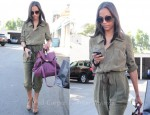 Sidewalk Style: Zoe Saldana Wearing A Bird by Juicy Couture Jumpsuit, Ann Taylor Sandals & See by Chloé Bag