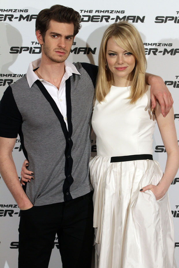 Andrew Garfield in Salvatore Ferragamo shirt, Burberry jeans, and Converse sneakers and Emma Stone in Jason Wu
