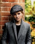 Giorgio Armani jacket,  Isabel Marant sweater,  Burberry Prorsum hat and Harry Winston earrings