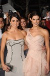 Nikki Reed in Versace and Ashley Green in Donna Karan Atelier