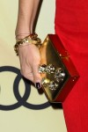 Connie Britton's Jerome C. Rousseau 'Jem Meteor' gold mirror leather clutch