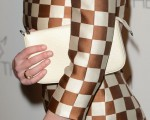 Kirsten Dunst's Louis Vuitton clutch