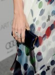 Camilla Belle's Jimmy Choo clutch and Van Cleef & Arpels jewels