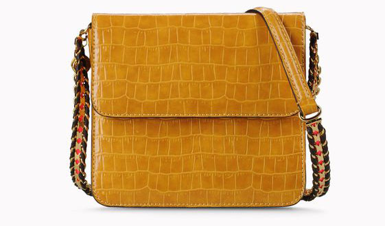 2804db4fd762 Anne s Stella McCartney  Grace  yellow cross-body flap bag with a chunky  chain strap is available to purchase in faux croc from Nordstrom.com.