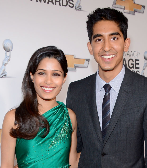 Freida Pinto in James Ferreira and Dev Patel in Burberry