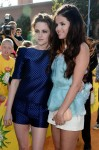 Kristen Stewart in Osman and Selena Gomez in Oscar de la Renta