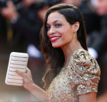 Rosario Dawson in Marchesa with Ferragamo clutch