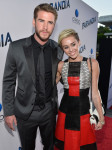 Liam Hemsworth in Hugo Boss and  Miley Cyrus in Proenza Schouler