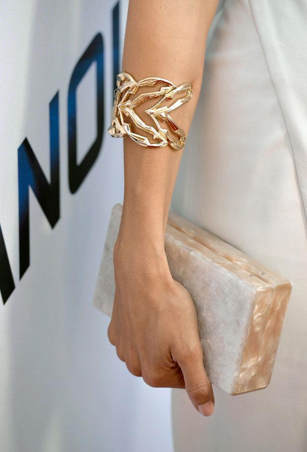 Angela Sarafyan's Edie Parker clutch and Jennifer Fisher cuff