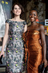 Michelle Dockery in Dior and Lupita Nyong'o in Lanvin