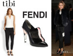 Olivia Palermo's Tibi Two-Tone Crossover-Front Jumpsuit And Fendi Fur-Trimmed Ankle Boots