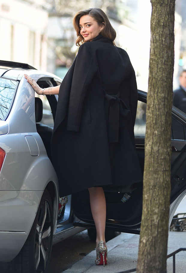 Miranda Kerr in Dolce & Gabbana and Escada