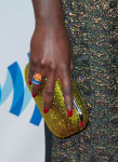 Lupita Nyong'o' Judith Leiber clutch and Leroy's Place Grace Jones ring