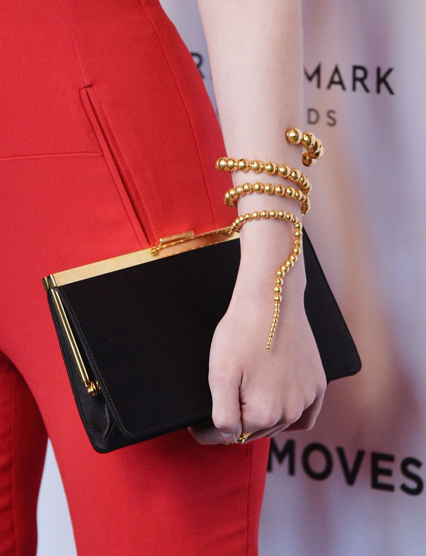 Dakota Fanning 's clutch and Paula Mendoza cuff