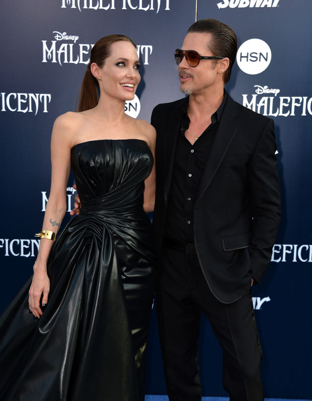 Angelina Jolie in Atelier Versace and Brad Pitt in Gucci