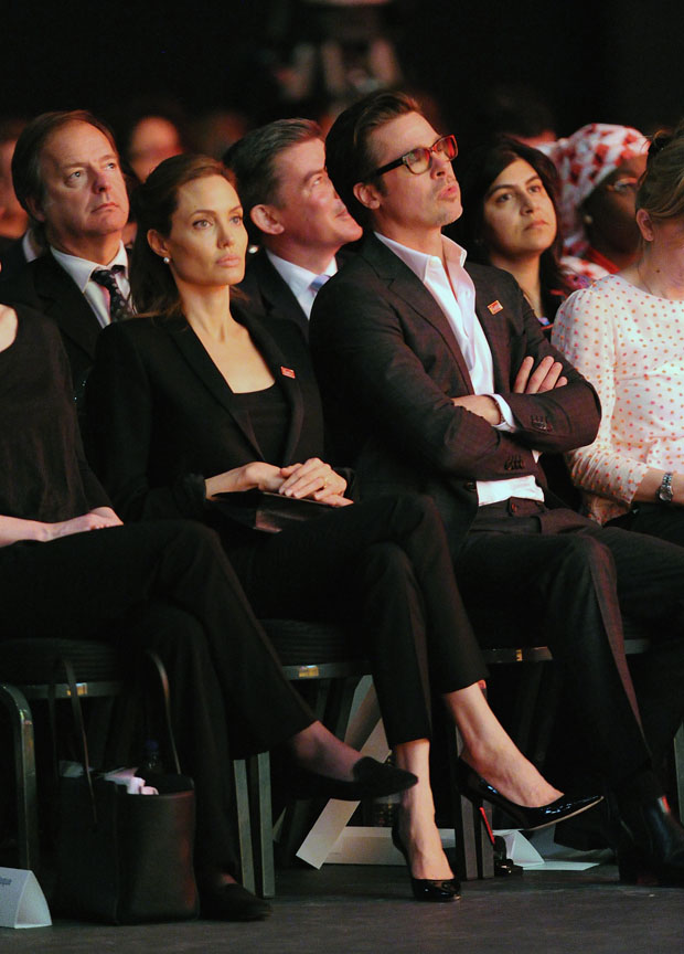 Brad Pitt in Ferragamo and  Angelina Jolie in Saint Laurent