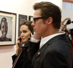 Brad Pitt in Ferragamo and  Angelina Jolie in Saint Laurent