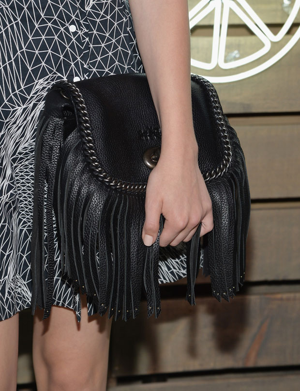Chloe Moretz' Coach 'Dakotah' whipstitch fringe flap bag.