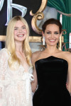 Elle Fanning in Alexander McQueen and Angelina Jolie in Atelier Versace