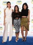 Kendall Jenner in Oriett Domenech,   Kim Kardashian in Balmain and Kylie Jenner in Sass & Bide
