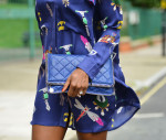 Mary Katrantzou Oriane Symbol-Print Silk Shirt Dress Stella McCartney Falabella Quilted Faux-Suede Clutch Fendi Mother-of-Pearl and Crystal Ring Kurt Geiger Glacier Sandals