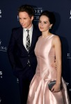 Felicity Jones in Dior and Eddie Redmayne in Alexander McQueen