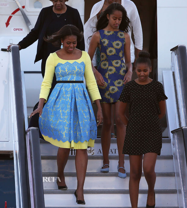 LONDON, ENGLAND - JUNE 15:  First Lady Michelle Obama arrives with daughters Malia Obama (C) and Sasha Obama (R) and her mother Marian Robinson(behind Michelle) at Stanstead airport on June 15, 2015 in London, England. The First Lady is travelling to London with her daughters, Malia and Sasha and her mother, Mrs. Marian Robinson, to continue a global tour promoting her Let Girls Learn Initiative.  During the visit she will meet with students at a girl's school to discuss how the UK and U.S. are working together to expand girl's education around the world.  (Photo by Dan Kitwood/Getty Images)