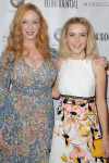 Christina Hendricks in BCBG Max Azria and Kiernan Shipka in Giamba