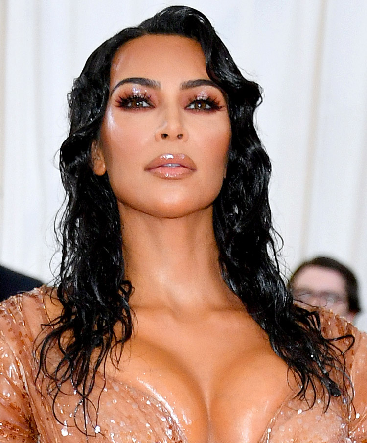 b0210d5bc7 Kim Kardashian channeled her inner Hollywood starlet on the red carpet for  the 2019 Met Gala.