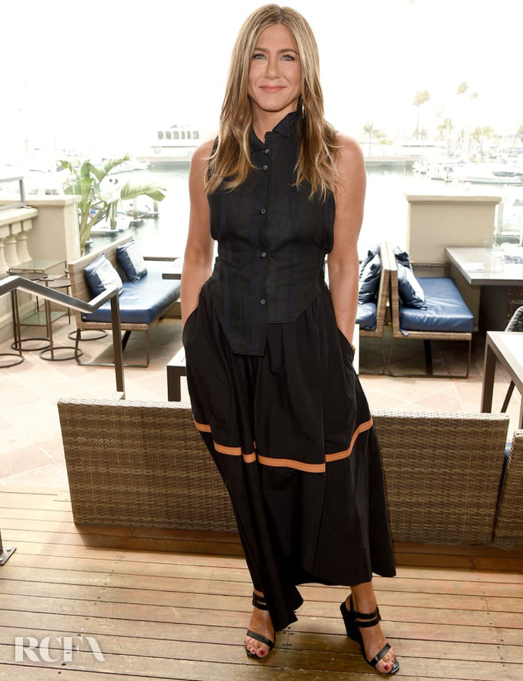 Jennifer Aniston Rocks Two Black Dresses While Promoting