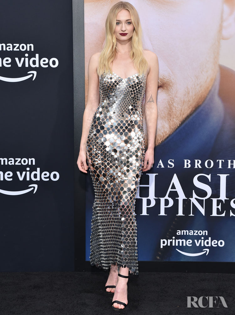 Sophie Turner Rocks A Silver Slinky Dress For The 'Chasing Happiness' LA Premiere