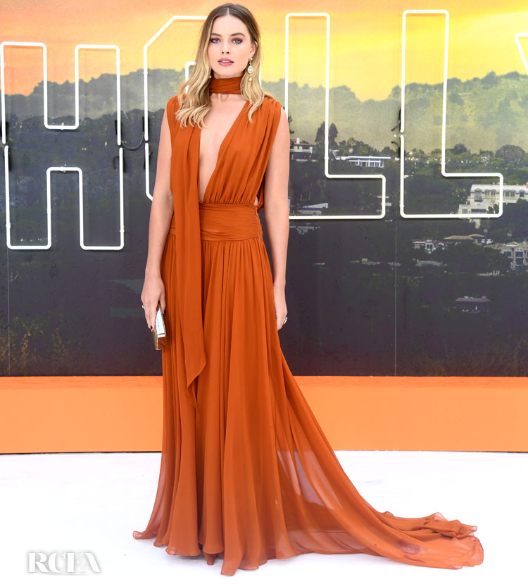 Margot Robbie Brings Her White Gown Run To A Halt For The 'Once Upon a Time In Hollywood' London Premiere