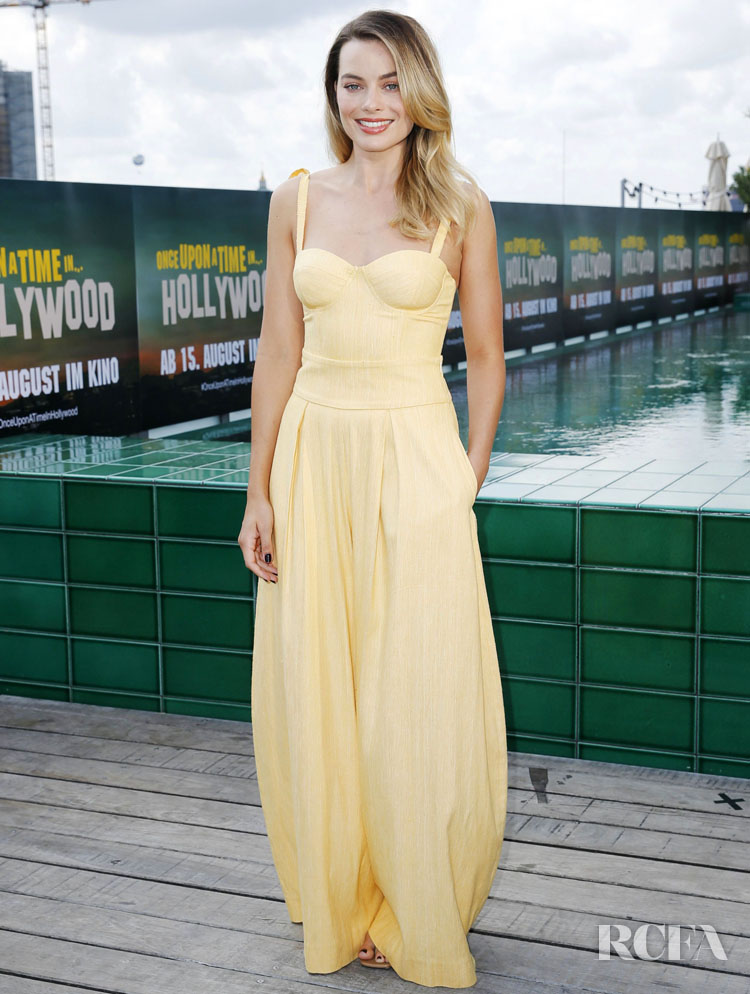 Margot Robbie Rocks A Yellow Look To The Berlin Photocall For The  'Once Upon a Time in Hollywood'